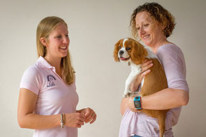Tutor with Student holding puppy at puppy school classes